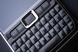 09-p8695-mobile-phone-stuck-keyboard.jpg